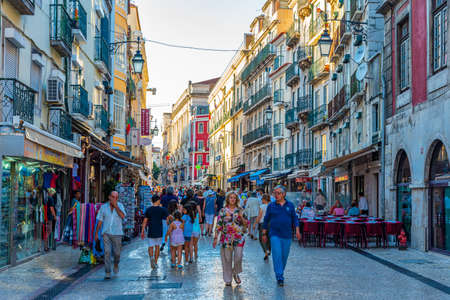 Photo for LISBON, PORTUGAL, JUNE 1, 2019: People are strolling on a narrow street in Lisbon, Portugal - Royalty Free Image