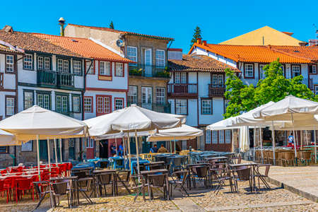 Photo for GUIMARAES, PORTUGAL, MAY 22, 2019: People are strolling over Praca de Sao Tiago in the old town of Guimaraes, Portugal - Royalty Free Image