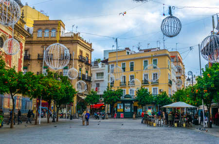 Photo for SEVILLA, SPAIN, JANUARY 7, 2016: people are strolling on the plaza del salvador in the spanish city sevilla - Royalty Free Image