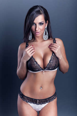 Photo pour sexy attractive brunette girl with big breasts in lingerie - image libre de droit