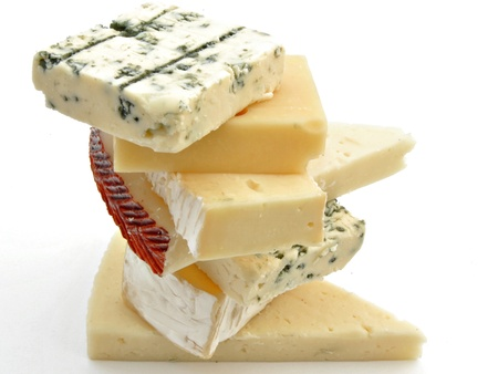Cheeses from different classes placed on each other surrounded by white