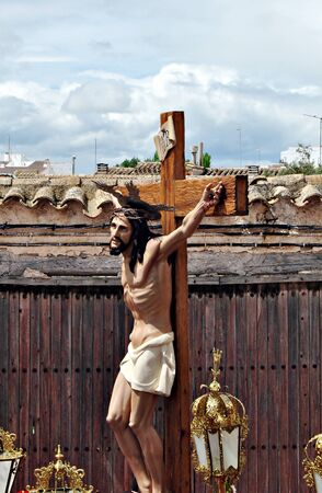 Jesus Christ on the cross during a procession of Holy Week in Spain