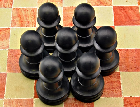 Several pawns black color on a board