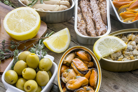 Foto de Assortment of cans of canned with different types of fish and seafood - Imagen libre de derechos