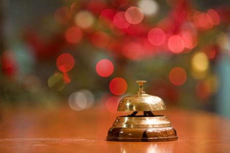 Foto für old hotel bell on a wood stand at Christmas holyday - Lizenzfreies Bild