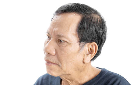 Photo pour old wrinkled asian man portrait with serious mood and wear navy blue t-shirt isolated on white background - image libre de droit
