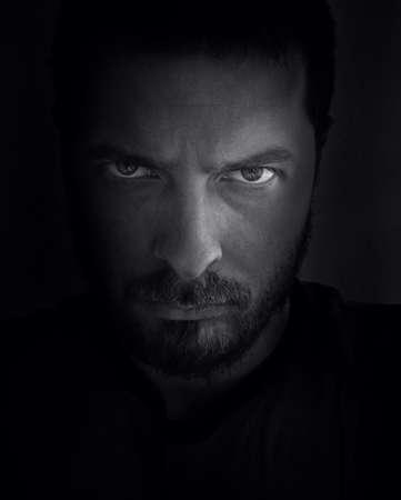 Low-key portrait of scary looking man