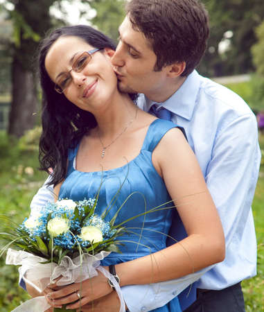 Cute couple in a kiss and hug romantic moment