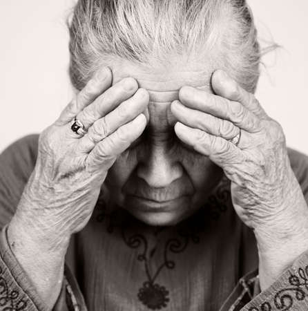 Unhappy old senior woman with health problems