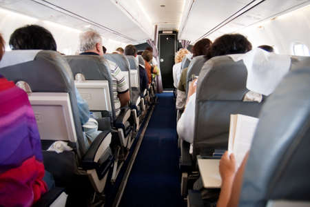 Interior of airplane with passengers on seats
