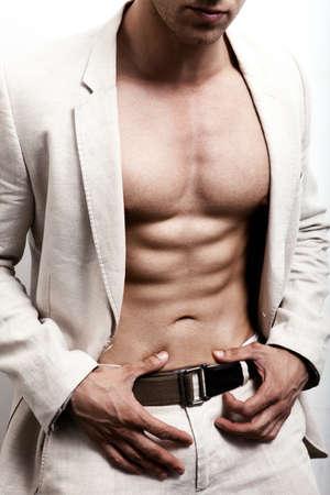 Foto de Man with sexy abs and elegant suit - Imagen libre de derechos