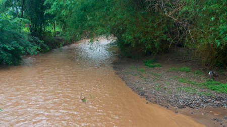 Flash floods in a DAM, visible water becomes turbid because it carries soil sediment along the river.
