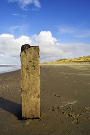 Close-up of wooden pole on the beach, Holland