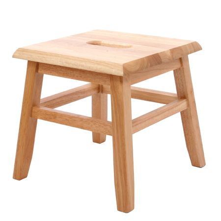 Small four legged wooden step stool over white