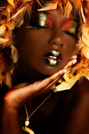 Foto de Beautiful african american woman in theatrical make-up close up. - Imagen libre de derechos