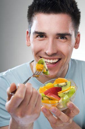 young man eating fruit close up shoot