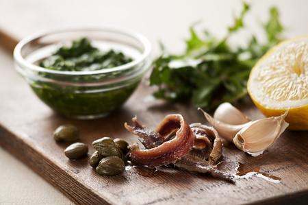 Anchovies with capers, garlic and lemon close up