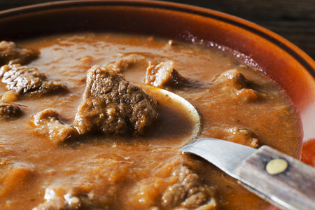 Portion of traditional Beef stew - goulash close up shoot