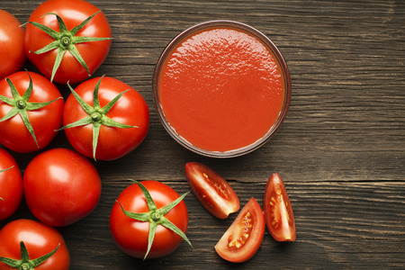 Photo for Fresh cherry tomato sauce on rustic wooden background - Royalty Free Image