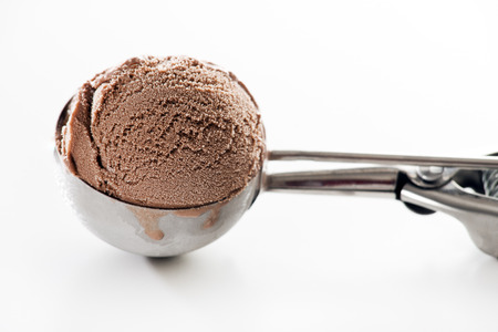Fresh chocolate ice cream scoop close up.