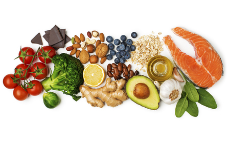 Selection of healthy food on white background. Healthy diet foods for heart cholesterol and diabetes.