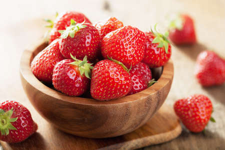 fresh strawberry in wooden bowl