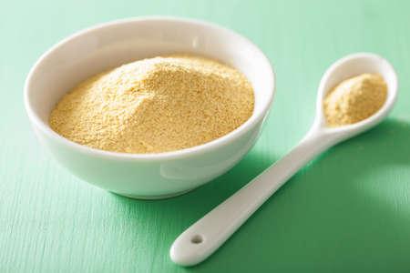 vegan nutritional yeast flakes in bowl