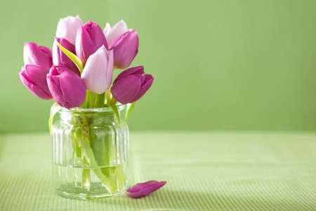 Foto de beautiful purple tulip flowers bouquet in vase - Imagen libre de derechos