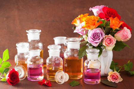 essential oil and rose flowers, aromatherapy spa perfumery