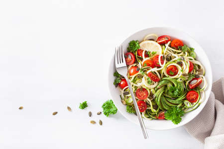 Photo for vegan ketogenic spiralized courgette salad with avocado tomato pumpkin seeds - Royalty Free Image