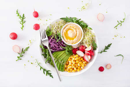 Photo for vegan avocado sweet corn lunch bowl with hummus, red cabbage, radish and sprouts - Royalty Free Image