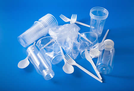 Photo for single use plastic cups, forks, spoons, bottles. concept of recycling plastic, plastic waste - Royalty Free Image