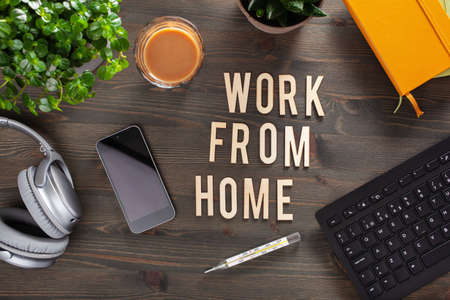Photo pour work from home text desk with keyboard computer smartphone notebook houseplants, workspace office at home - image libre de droit