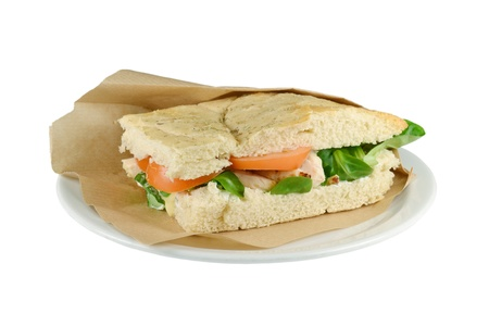 Upscale sandwich with chicken strips on a white background