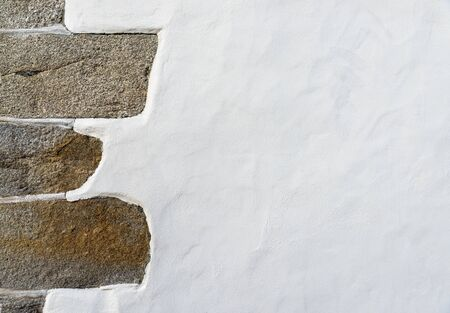 White wall with a stone left corner