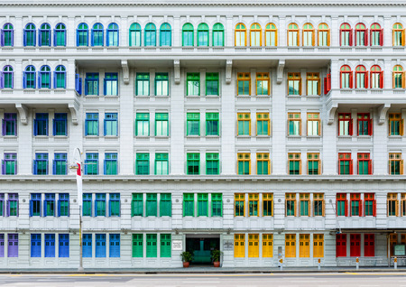 Old Hill Street Police Station historic building in Singapore. Neo-classical style building with colorful windows.