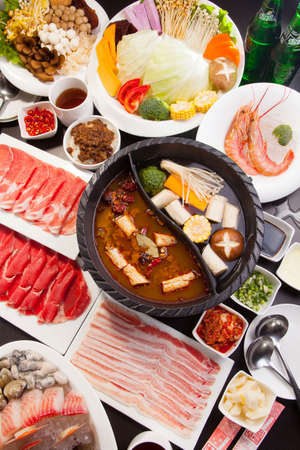 A special hot pot in Chinese style with beef, pork, seafood, mushroom, vegetables, shrimps and herbs