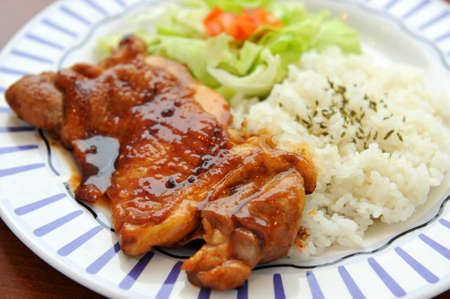 Platter of rice with grilled pork ribs  and lettuce