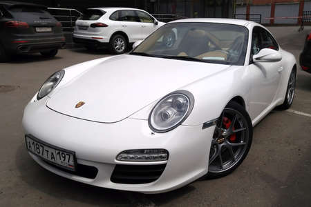 Moscow. Autumn 2018. White Porsche 911 tuned with BBS Wheels. Stands on the parking.