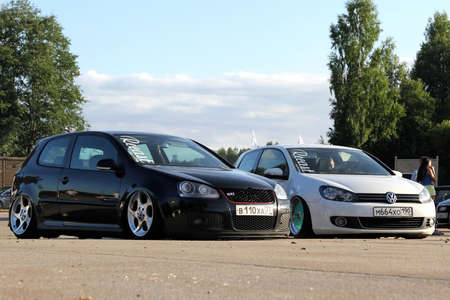 Moscow. Russia - May 20, 2019: Black Volkswagen Golf mk 5 and white mk 6 in tuning on air suspension, low and with wide wheels. They are parked on the street.