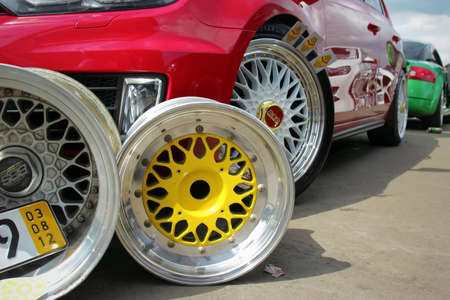 Moscow. Russia - May 20, 2019: colorful BBS wheels near red tuned hatchback which parked on the street