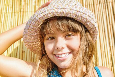 Adorable little girl with the summer hat