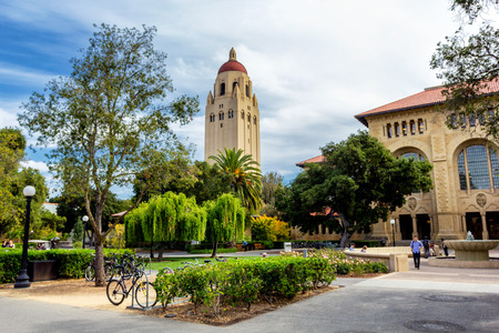 PALO ALTO, USA - OCTOBER, 2013: Hoover tower and green trees in Stanford University campus