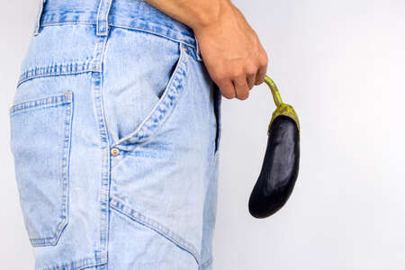 Photo for young man holding eggplant near  his crotch - Royalty Free Image