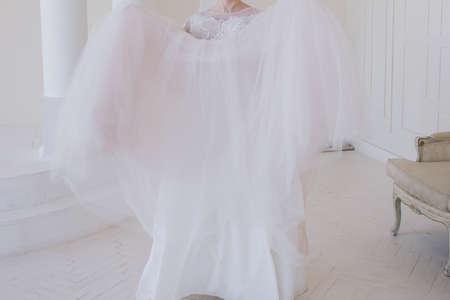 Foto für bride in a wedding dress in bright room - Lizenzfreies Bild
