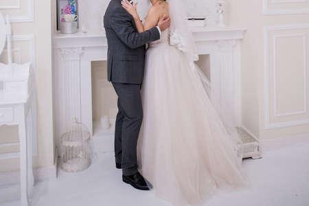 Photo pour the groom with the bride in the studio - image libre de droit
