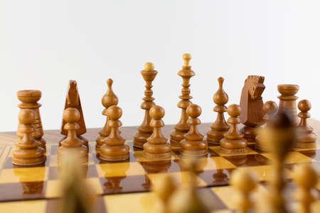 Photo pour a chessboard made of wooden pieces on white - image libre de droit