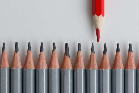 Photo for Support Group, Intervention. Conceptual. Red and gray pencils opposite each other on an isolated background. Shallow depth of field - Royalty Free Image