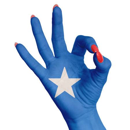 Photo pour Somalia national flag painted on female hand showing ok sign. Image on a white background - image libre de droit