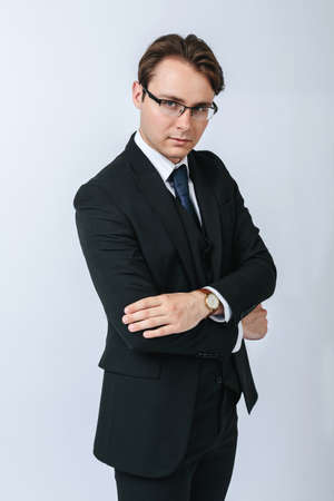 Photo for Business and finance concept. Portrait of a businessman in a black suit with glasses. Light background - Royalty Free Image